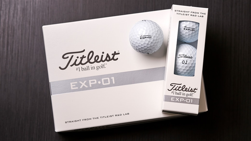 Photo of new Titleist EXP•01 golf ball dozen, 3-ball sleeve and single ball