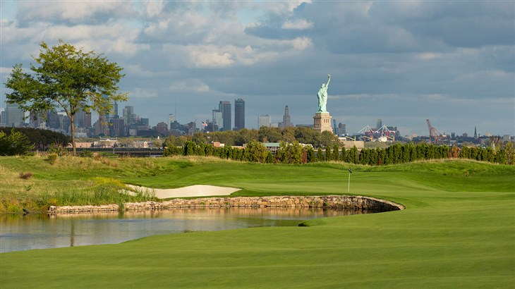 View of Liberty National Golf Course with Statue of Liberty in the distance.