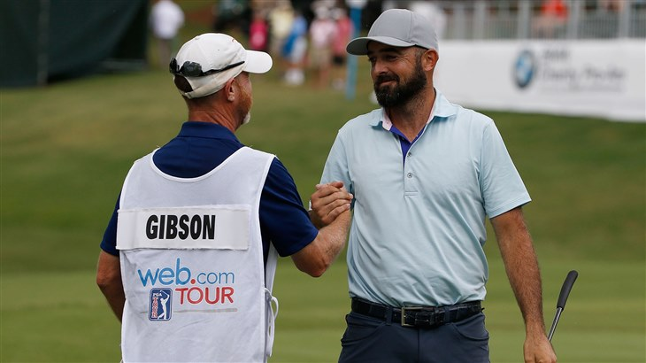 Rhein Gibson celebrates with his caddying after carding an 8-under-par 63 to close out the BMW Charity Pro-Am